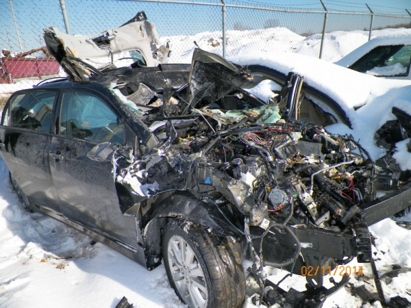 A car was demolished in South Portland on Tuesday after a tractor-trailer struck it from behind.