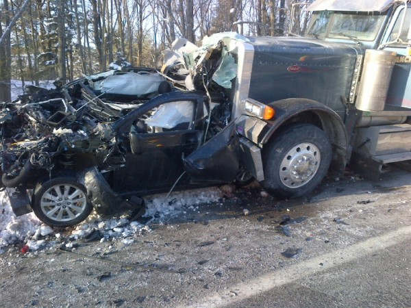 A tractor-trailer crashed into a car in South Portland on Tuesday. The car was demolished.