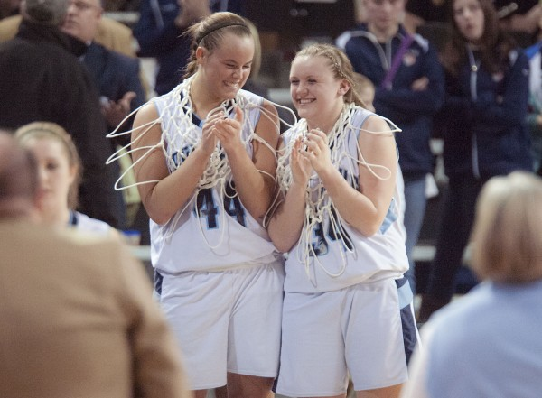 Calais girls basketball players Paige Gillespie (44) and Taylorae Carter (34) are all smiles as they enjoy their victory over Orono in the Eastern Maine Class C championship at the Cross Insurance Center in Bangor on Saturday.