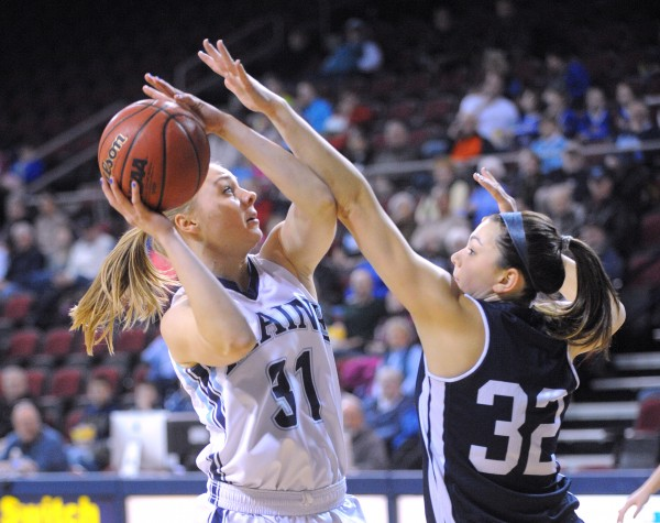 In this January 2014 file photo, Yale University's Meredith Boardman (right) tries to block a shot by the University of Maine's Liz Wood during their game at the Cross Insurance Center in Bangor.