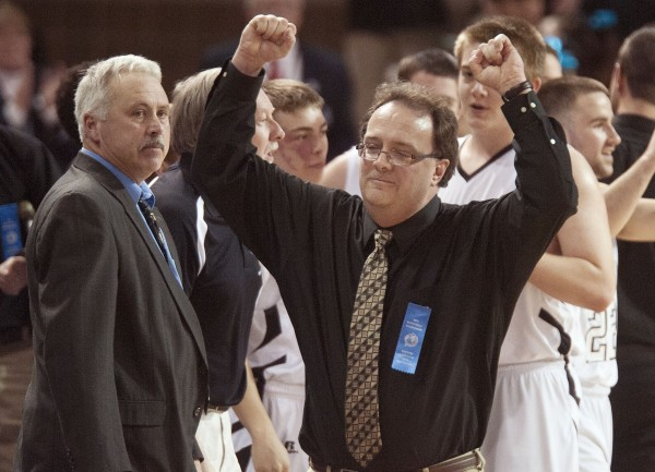 Lee Academy boys basketball coach Randy Harris (left) watches as Houlton boys basketball coach Robert Moran raises his hands in triumph as Houlton wins the Eastern Maine Class C championship at the Cross Insurance Center in Bangor on Saturday.