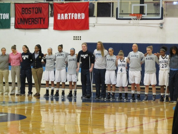 The University of Maine women's basketball team lines up for The Star Spangled Banner prior to a game against New Hampshire on March 3, 2013 at Memorial Gym in Orono. It was the Black Bears' first game since their team bus crashed on Feb. 26, 2013 in Massachusetts on the way to a game in Boston.