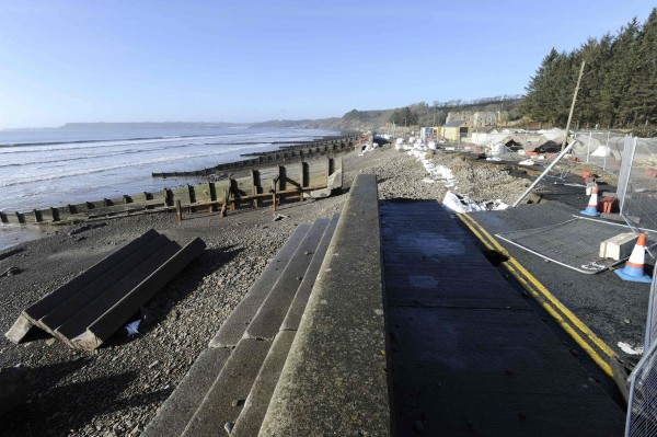 A view of storm damage on the collapsed coastal road which runs through Amroth in Pembrokeshire, Wales, Feb. 16, 2014.