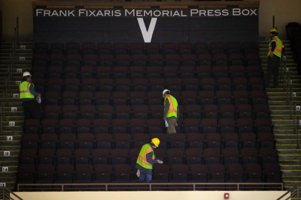 Workmen clean new seats at the Cumberland County Cicic Center on Monday. The renovated space will reopen this weekend.