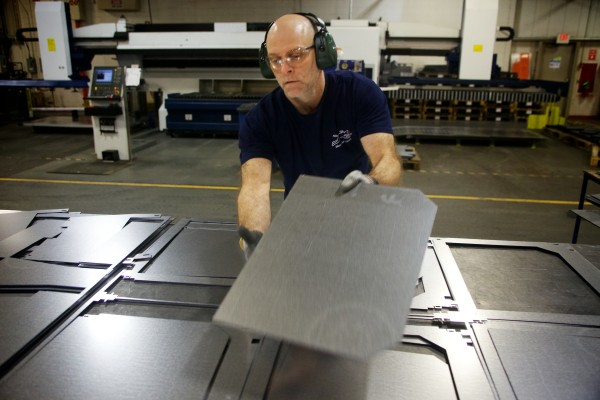 Mike Mattison separates sheet metal parts at Jotul North America's wood and gas stove manufacturing facility in Gorham on Friday.