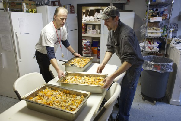 Alan Cunningham (left) of Bangor and Dale Small of LaGrange prepare noodles for a meal Friday at The Together Place in Bangor. Both are in the ReFinement program, which allows people convicted of crimes to pay fines back through community service. Every year in Maine people convicted of crimes are unable to pay the fines imposed as part of their sentences. A law passed last year allows judges to order people who are unable to pay fines to do community service. Penobscot County is the first in Maine to monitor folks ordered to do community service.