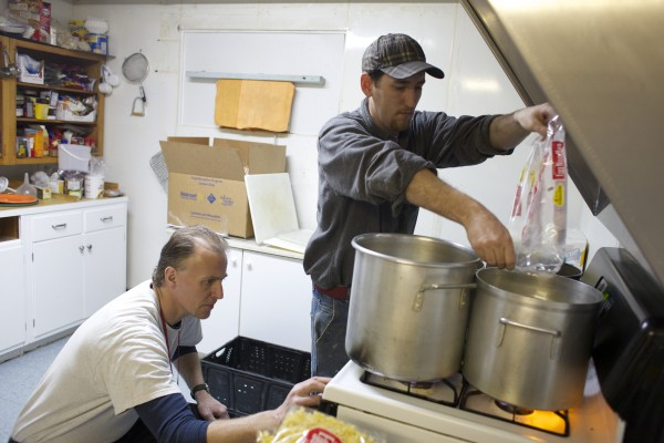 Alan Cunningham (left) of Bangor and Dale Small of LaGrange prepare noodles for a meal Friday morning at The Together Place in Bangor.