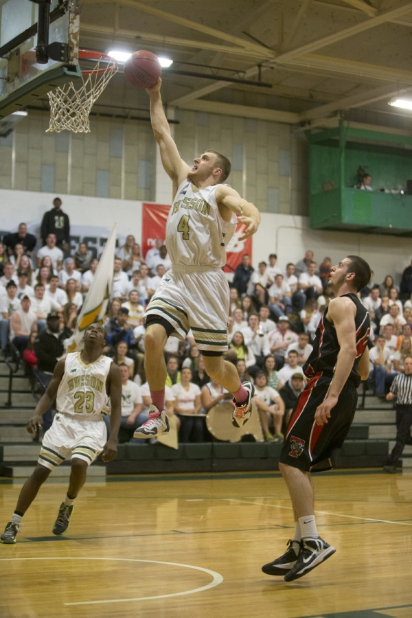 Husson University's Brooks Spaulding dunks the ball during a recent game against Thomas College at Newman Gym in Bangor.