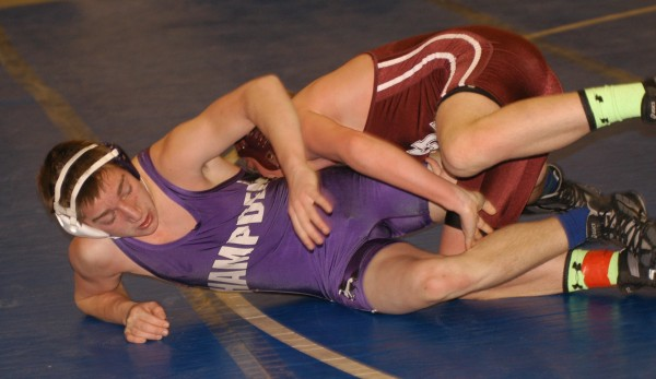 Hamoden Academy's Patrick DeArmott tries to elude the grasp of Edward Little's Skyler bang in their 145-pound match during the Eastern A championships Saturday at Mount Ararat in Topsham.