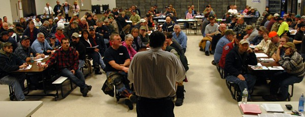 More than 200 workers at Lincoln Paper and Tissue LLC listen as state Department of Labor and union officials brief them on unemployment benefits during a meeting at Mattamawcook Academy of Lincoln on Thursday, Dec. 19, 2013.