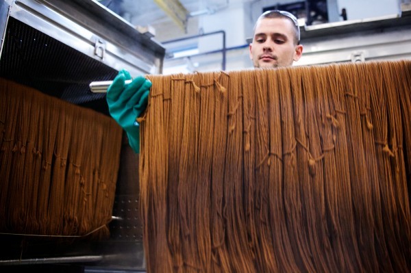 Max Marcous checks woolen yarn half way through the dyeing process at Saco River Dyehouse in Biddeford on Tuesday. The operation is the only organically certified yarn dyeing operation in the country.