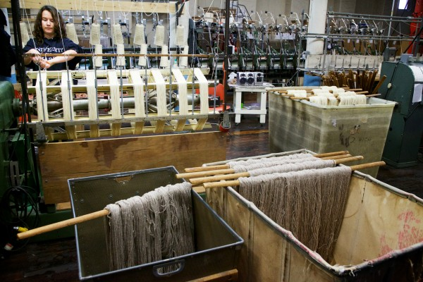 Brittany Carle skeins Persian wool yarn at the Saco River Dyehouse in Biddeford on Tuesday. The wool will then be dyed one of 410 colors the operation currently offers.