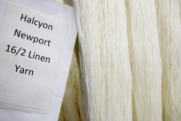 Fine linen yarn hangs on a rack in skeins at the Saco River Dye House in Biddeford on Tuesday.