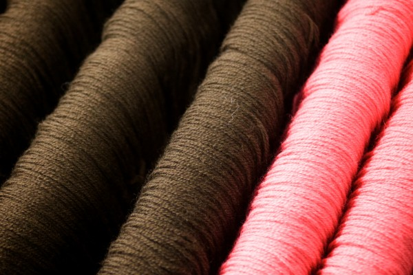 Two of the 410 colors currently offered by the Saco River Dyehouse hang in skeins at their facility in the historic Westpoint-Stevens Mill on Main Street in Biddeford.