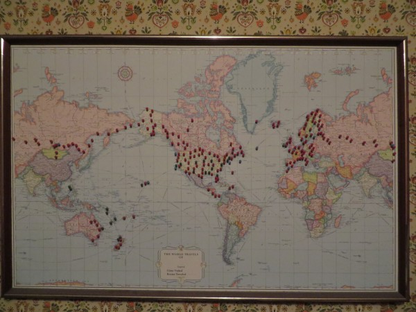 This world map on Jeanette Beaton's kitchen wall shows all the places she has been. Beaton, age 94, has traveled to 105 different places around the world.