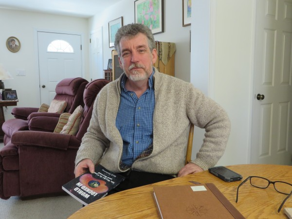 Mark Hathaway, survivor of &quotlocked-in syndrome,&quot sits in his Litchfield home in this February 2014 photo.