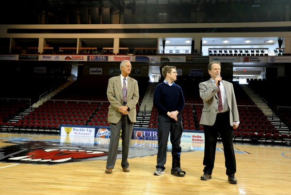 Mike Dyer (right), general manager of the Cross Center; Bangor mayor Ben Sprague (center) and Jerry Goss, co-director of the Eastern Maine High School Basketball Tournament, speak at a Thursday press conference before the Friday start of the 2014 basketball tournament at the Cross Insurance Center.