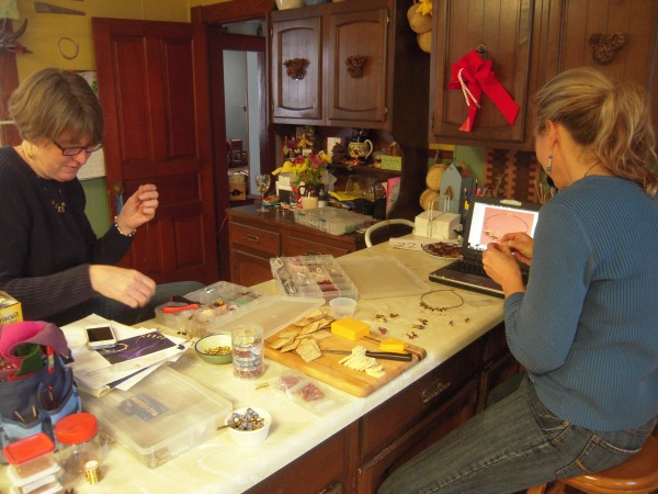 Polly Earl and Barbara Hayslett work to build their inventory of biathlon-inspired jewelry in advance of the World Junior Championships, which start Feb. 28 in Presque Isle.
