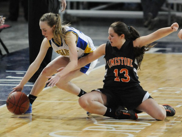 Van Buren's Courtney Parent (left) and Limestone's Kassee Albert chase down a loose ball at the Cross Insurance Center during class D girls action on Monday.