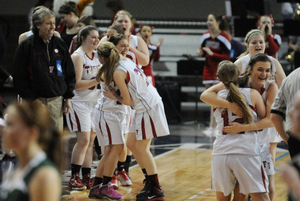 Members of the Fort Fairfield girls basketball team celebrate their victory over Penobscot Valley High School on Monday at the Cross Insurance Center during Class D action.