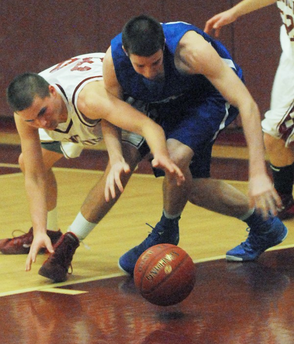 Bangor High School's Trey Kenny (left) scrambles for a loose ball against Lawrence High School's Seth Powers during the third quarter of Tuesday night's Class A basketball game at Bangor High School. The Rams won 82-51.