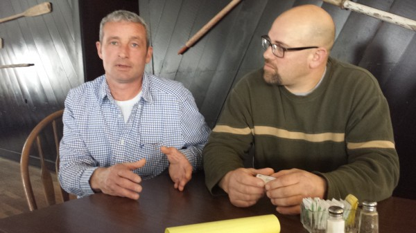 From left, Tracy Sawtell and Joshua Lyons, Lubec fishermen, speak with reporters. Sawtell, Lyons, and other fishermen from the Cobscook Bay region criticized state officials for recently closing the region to scallop fishing the remainder of the season.