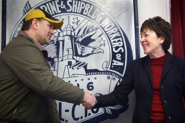 "Jay Wadleigh, president of Local S6, the largest union at Bath Iron Works, shakes hands with U.S. Sen. Susan Collins at his union hall in Bath on Tuesday. Collins said a $21 million contract for design work on a new class of U.S. Coast Guard cutter was only part of ""a very good year"" for the shipyard."