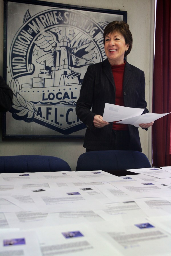 Sen. Susan Collins looks over hundreds of thank you letters presented to her at Local S6 union headquarters in Bath on Tuesday. Union members thanked her for her work on the Senate Appropriations Committee.