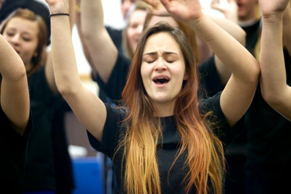 Sierra Marston sings &quotI Want to Know What Love Is&quot with other members of the Deering High School chorus in Portland on Tuesday. The students will perform the song with the band Foreigner on Feb. 18 at the the State Theatre.