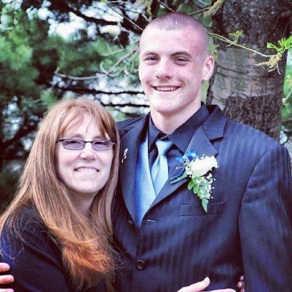 Brooks Spaulding and his mother, Sheri Fuller-Spaulding, pose for a photo before his high school junior prom.