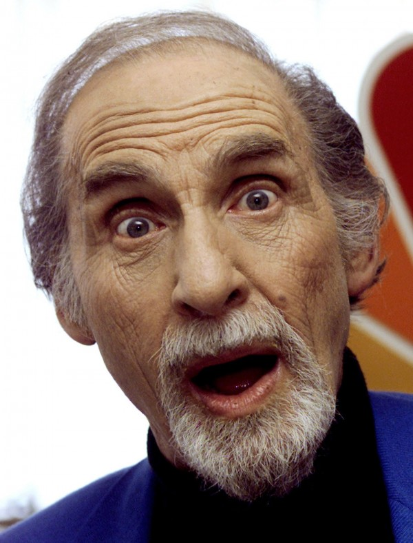 Entertainer Sid Caesar jokes with photographers after a luncheon celebrating NBC's 75th anniversary in Hollywood, Calif., in April 2002.