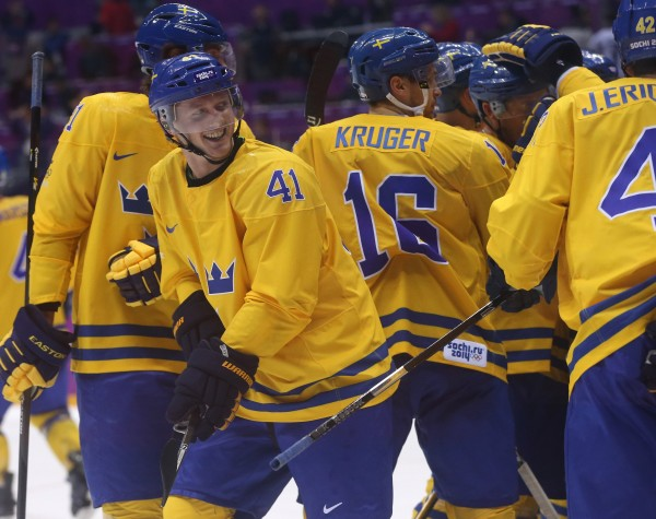 Sweden forward Gustav Nyquist (41), a former University of Maine star, celebrates his team's win over Finland in a men's hockey semifinal at Bolshoy Ice Dome during the Winter Olympics in Sochi, Russia, Friday, Feb. 21, 2014. Sweden defeated Finland 2-1 to advance to the gold-medal game.