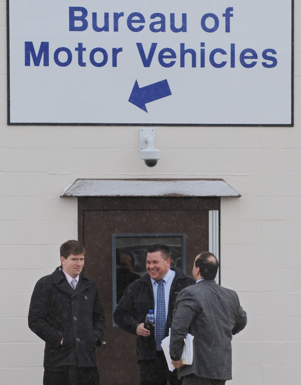 Glenn Geiser Jr. (center), his attorney Joe Baldacci (right) and Eugene M. Sullivan Jr., Baldacci's associate, leave the Bureau of Motor Vehicles at the Airport Mall in Bangor through the back door after a public hearing Monday was postponed.