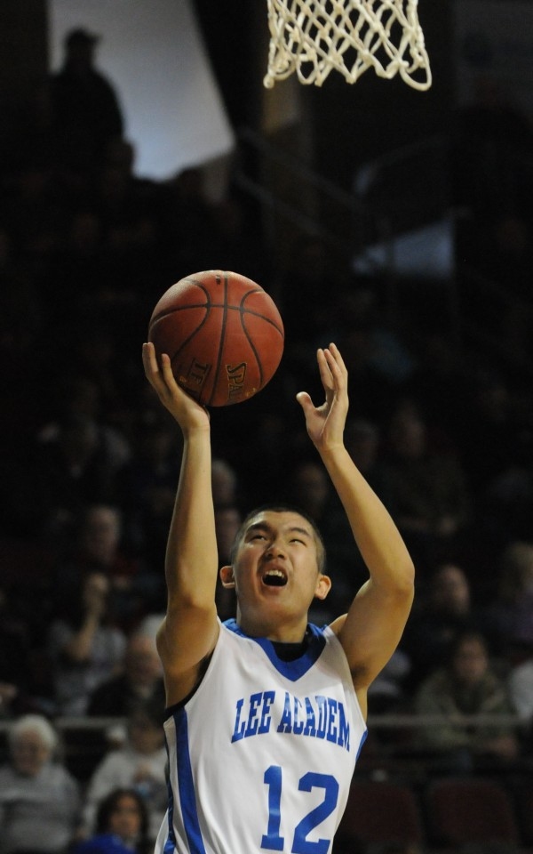 Lee Academy's Charles Tung-Fang  takes a shot while playing against George Stevens Academy on Tuesday at the Cross Insurance Center.
