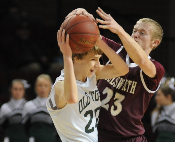 Old Town's Tyler Gifford keeps control of the ball from Ellsworth's Steven Mahon during the second half of Wednesday afternoon's Class B semifinal game at the Cross Insurance Center.