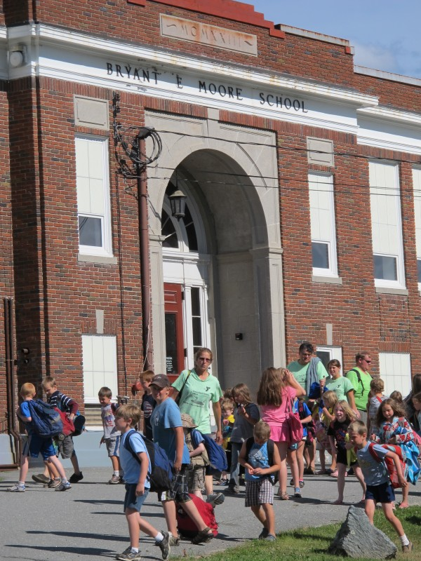 In this July 2012 file photo, children from the Down East Family YMCA day camp arrive at the former Bryant E. Moore school on State Street in Ellsworth. City councilors on Monday, Feb. 10, gave final approval for an estimated $4.6 million renovation of the building to convert it into the Moore Community Center.
