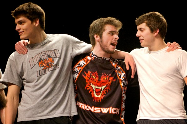 Brunswick High School varsity athletes Elliot Boyd (from left) George Rowe and Reece Reed play their parts as members of the Jets gang in &quotWest Side Story&quot after school on Thursday.