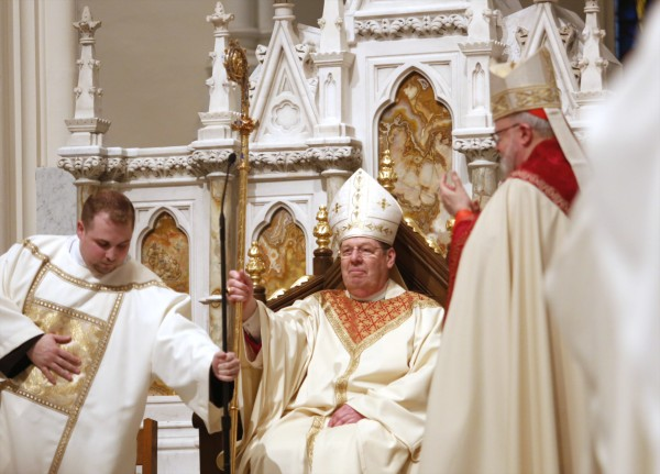 Bishop Robert Deeley sits in the cathedra for the first time after being installed as the 12th bishop of the Roman Catholic Church of Maine, at the Cathedral of the Immaculate Conception in Portland on Friday.