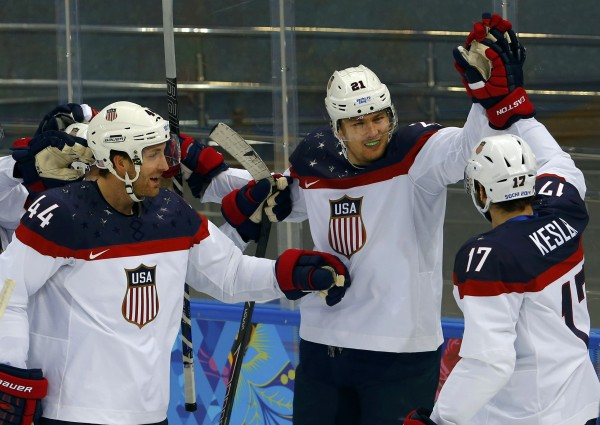 Team USA's James van Riemsdyk (center) is congratulated by teammates Brooks Orpik (left) and Ryan Kesler after scoring a goal against Czech Republic during the first period of their men's quarter-finals ice hockey game at the Sochi 2014 Winter Olympic Games February 19, 2014.