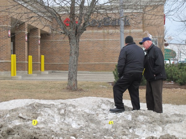 Ellsworth police Lt. Harold Page, right, talks to Detective Alan Brown of the Hancock County Sheriff's Department outside Key Bank on High Street on Monday. Police were investigating a robbery at the bank that had occurred earlier in the afternoon.