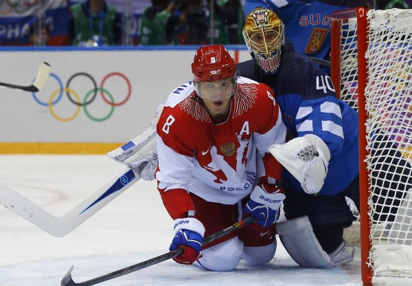 Finland's goalie Tuukka Rask attempts to tie up Russia's Alexander Ovechkin during the second period of their men's quarter-finals ice hockey game at the 2014 Sochi Winter Olympic Games, on Feb. 19, 2014.
