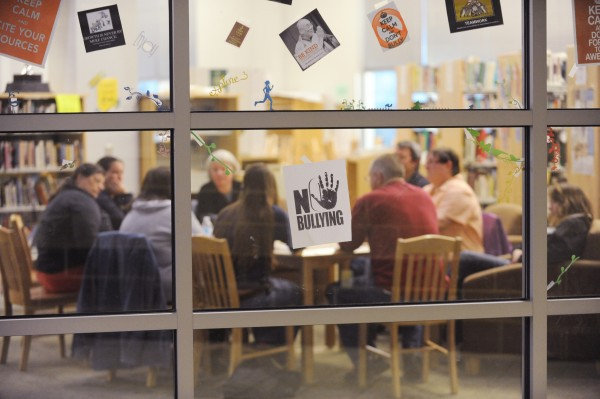A no bullying sign is seen in the window of the library of Mount View High School as members of the National Alliance of Mental Illness meet with the public behind locked doors to talk about suicide prevention and grieving.