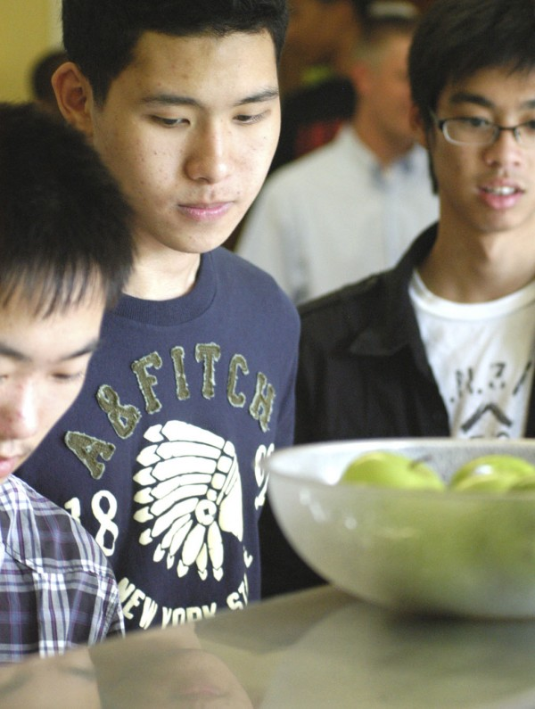 In this September 2009 file photo, Asian students get into the lunch line at Lee Academy. For 2014, 128 international students pay $4 million in tuition, room and board at the school. Talks are underway with Lee Academy to let the private school assume operation of Millinocket''s public schools.