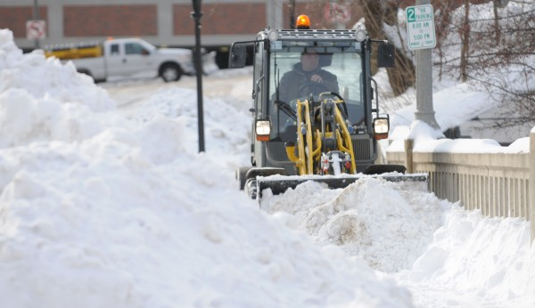Snow removal equipment pushes snow along the sidewalk on Franklin Street in downtown Bangor last weekend.
