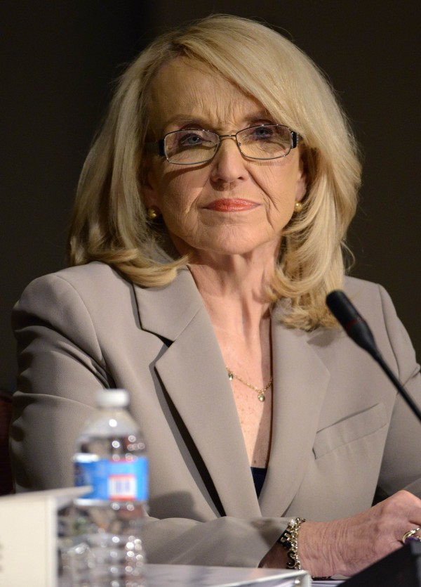 Arizona Republican Governor Jan Brewer listens to testimonies during the Economic Development and Commerce Committee meeting at the National Governors Association Winter Meeting in Washington on Saturday.