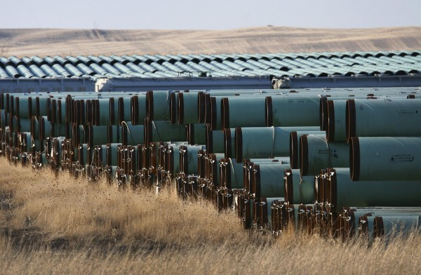 Pipes for underground fuel transport for TransCanada Corp.'s Keystone XL pipeline lie in a field in Gascoyne, N.D., in this April 2013 file photo.