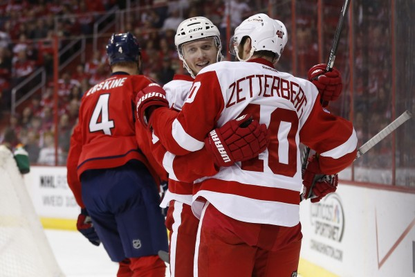 Detroit Red Wings center Gustav Nyquist (center) celebrates with Red Wings left wing Henrik Zetterberg (right) after scoring a goal against the Washington Capitals at Verizon Center on Sunday.
