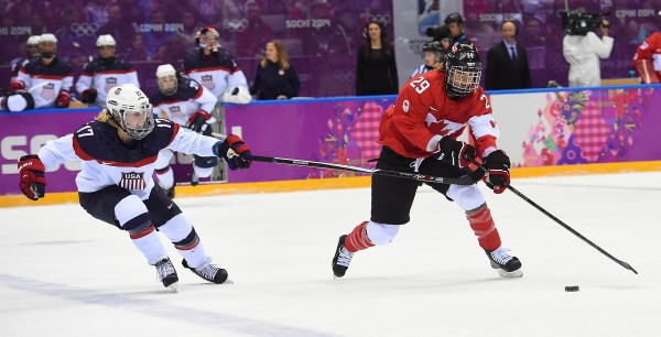USA forward Jocelyne Lamoureux (left) tries to defend against Canada forward Marie-Philip Poulin during the third period of the women's gold medal hockey game at the Winter Olympics in Sochi, Russia, on Thursday.