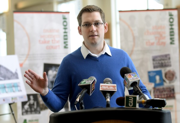 Bangor City Council Chairman Ben Sprague speaks at a media event on Wednesday where the Maine Basketball Hall of Fame announced that it will have a permanent exhibit in the Cross Insurance Center.