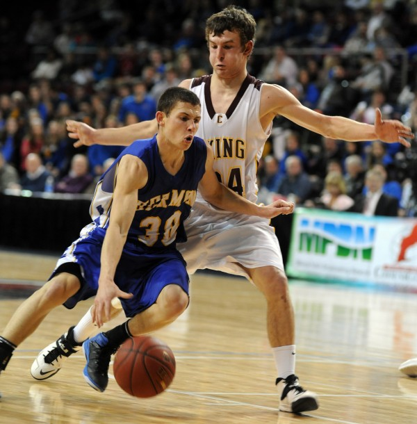 Hermon's Tyler Thayer drives by Caribou's Matthew Milliard in the second half of a Class B semifinal game Wednesday at the Cross Insurance Center.